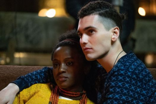 A white man sits with his arm around a black woman in Peacock's Noughts + Crosses