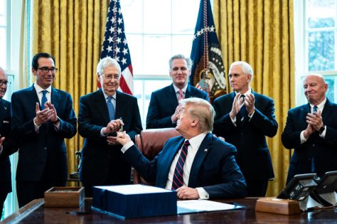 President Trump Signs Coronavirus Stimulus Bill In The Oval Office