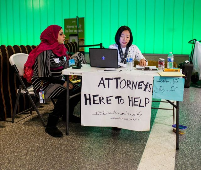 A Volunteer Attorney And Volunteer Translator Stationed At Los Angeles International Airport In February When The First Version Of President Trumps Travel