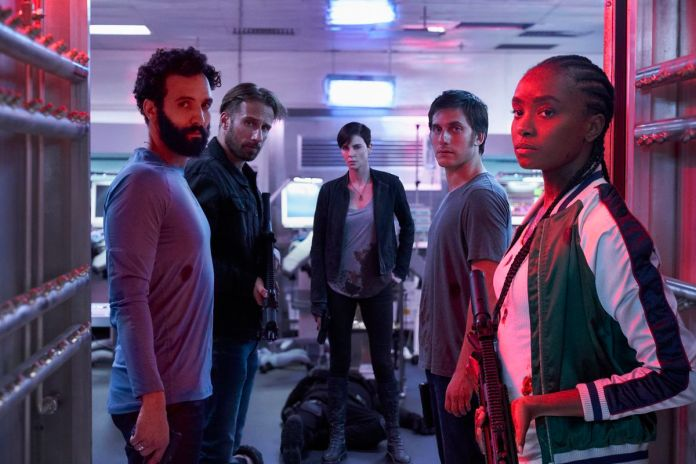 Marwan Kenzari as Joe, Matthias Schoenaerts as Booker, Charlize Theron as Andy, Luca Marinelli as Nicky, Kiki Layne as Nile in The Old Guard.