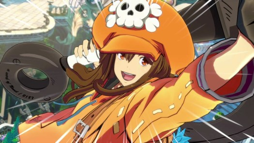 Guilty Gear character May smiles at the camera, wearing a bright orange outfit