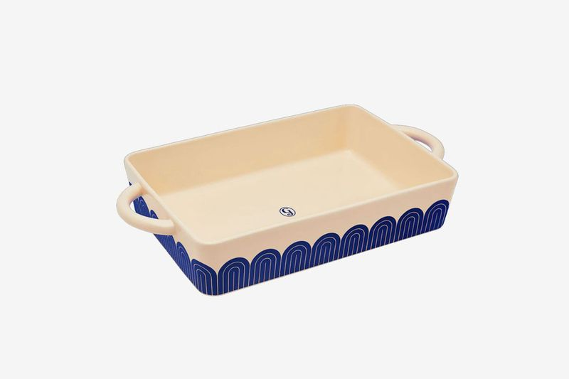 a casserole dish with a blue pattern around the side
