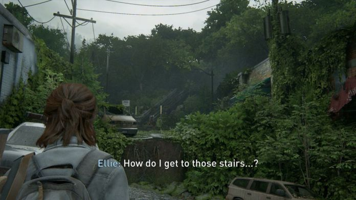 "Ellie looks off into the distance and sees stairs she must get to, and says, ""How do I get to those stairs...?"""