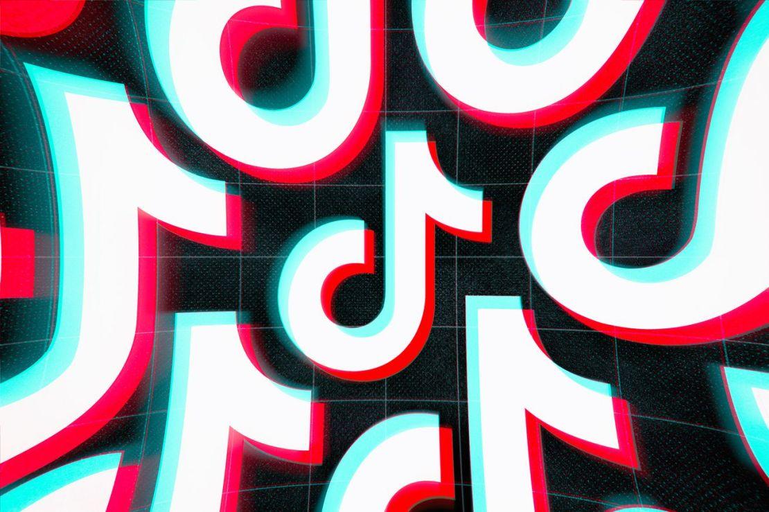 Tessellated TikTok logos against a dark background.