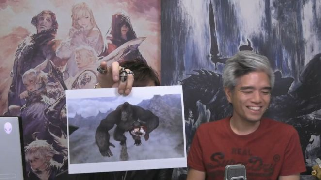 Naoki Yoshida holds up a photo of a gorilla carrying a lalafell while Toshio Murouchi laughs