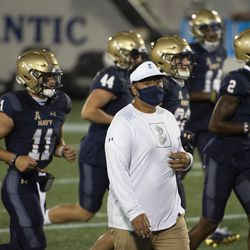 Navy head coach Ken Niumatalolo walks with his team of the field before an NCAA college football game against the BYU, Monday, Sept. 7, 2020, in Annapolis, Md.