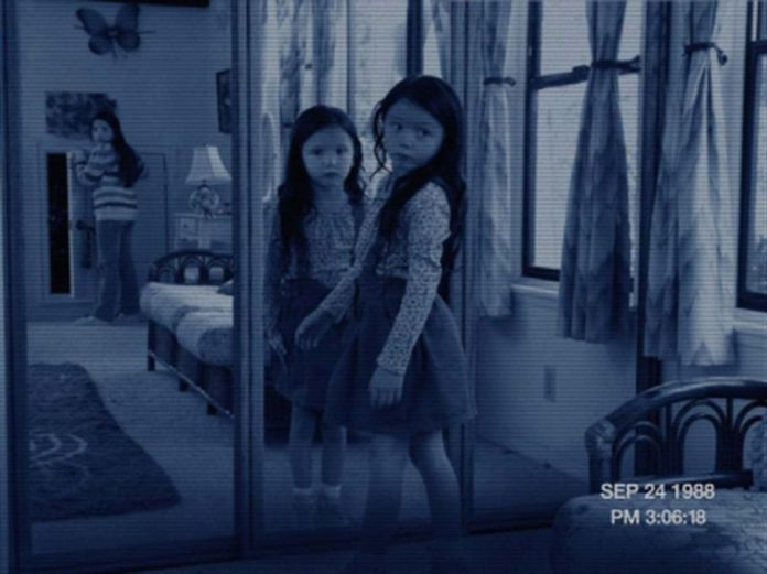 A little girl turns around but her mirror image does not! in Paranormal Activity 3
