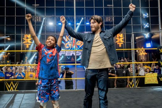 leo raises his hands triumphantly in the ring
