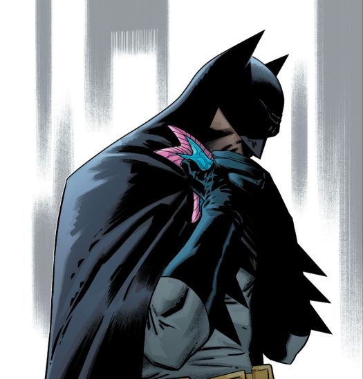 Jarro, who is a small blue starfish from space with a pink border and one central eye, shares an embrace with Batman, in Justice League #29, DC Comics (2019).