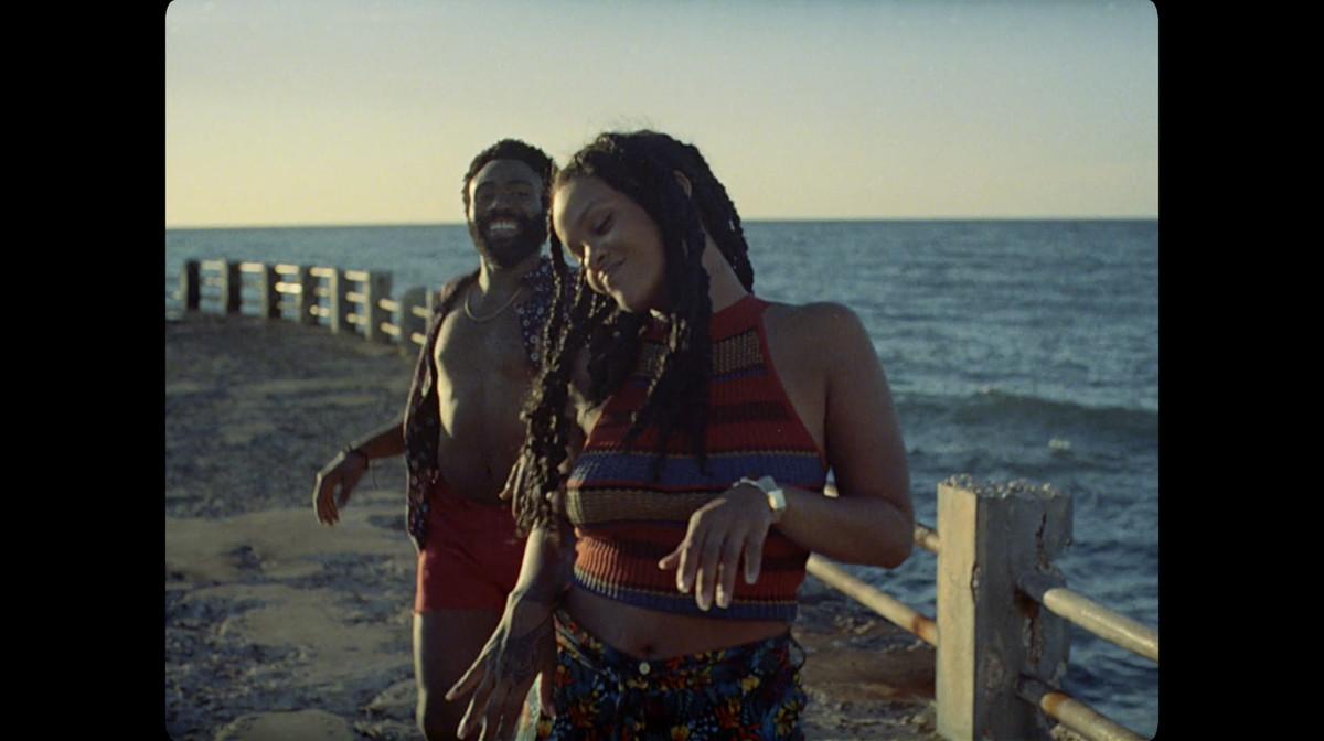 """Deni (Glover) and Kofi (Rihanna) dancing to """"Summertime Magic."""""""