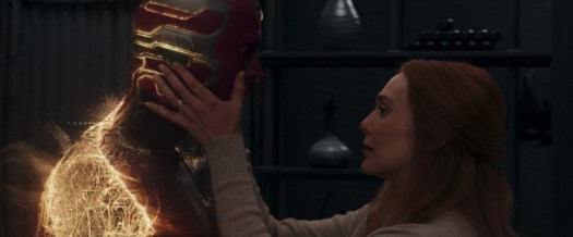 Wanda holds Vision's face as he dematerializes in WandaVision.
