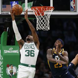Boston Celtics' Marcus Smart (36) goes to the basket past Utah Jazz's Royce O'Neale during the first quarter of an NBA basketball game Friday, March 6, 2020, in Boston.