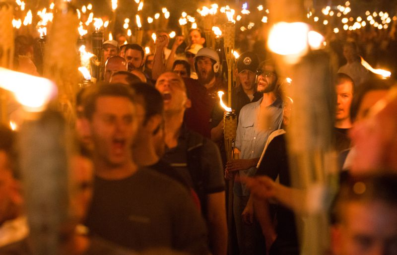 White supremacists hold torches on UVA grounds.