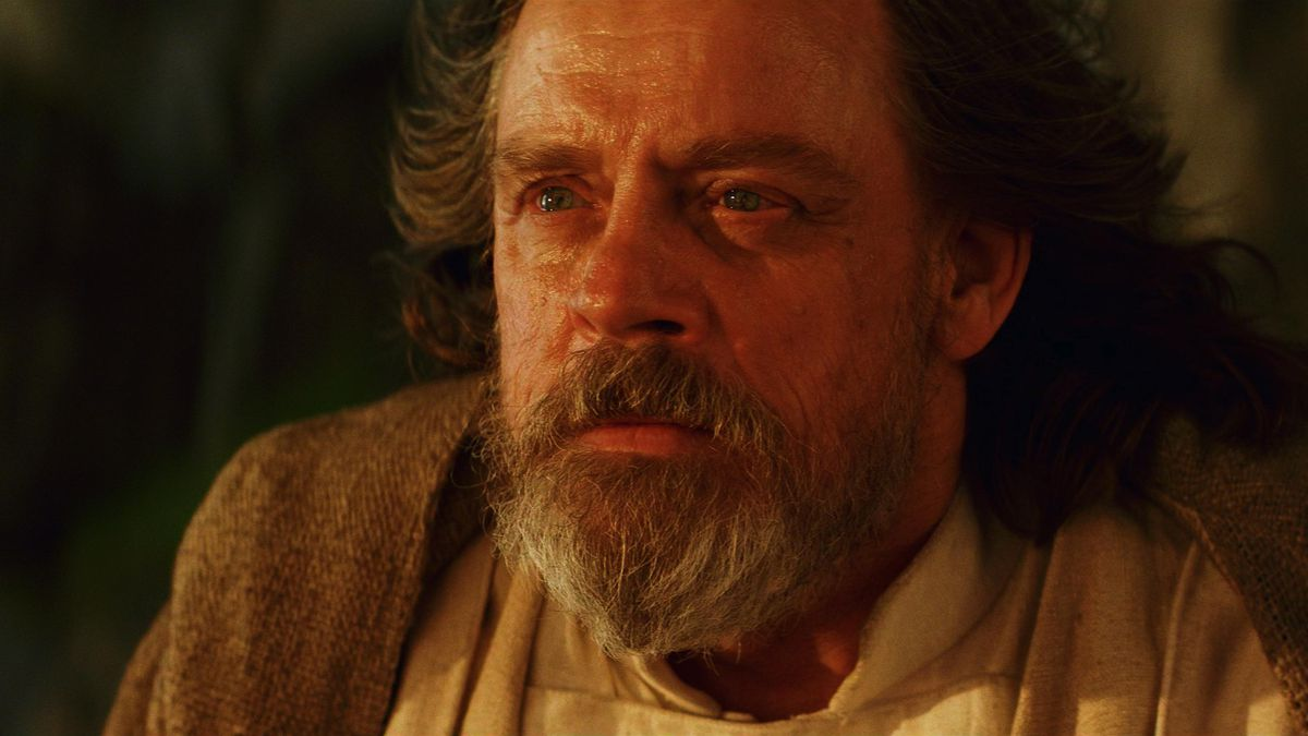 old luke skywalker in close up with tears in his eyes