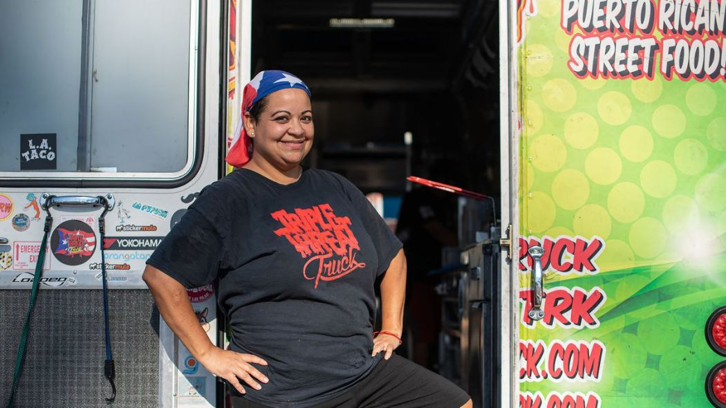 Omarya Dakis, chef of the Triple Threat Truck in Los Angeles, standing at the door of her truck.