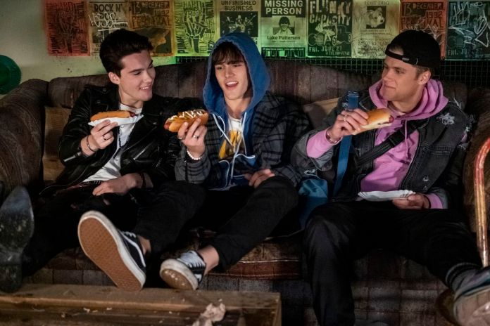 the boy band about to chow down on some hot dogs