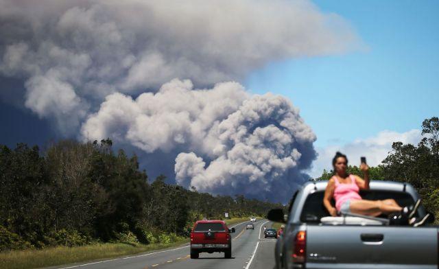 An ash plume rises from the Kilauea volcano on Hawaii's Big Island on May 15, 2018.