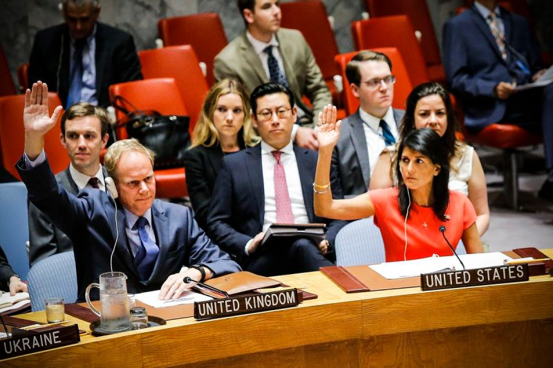 US Ambassador to the United Nations Nikki Haley and Britain's Ambassador Matthew Rycroft vote on a US-drafted resolution toughening sanctions on North Korea on August 5, 2017.