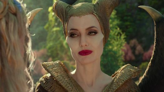 Maleficent (Jolie) looks fondly at Aurora (Elle Fanning).