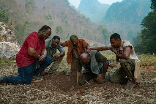 a group of men kneeling together in Spike Lee's Da 5 Bloods