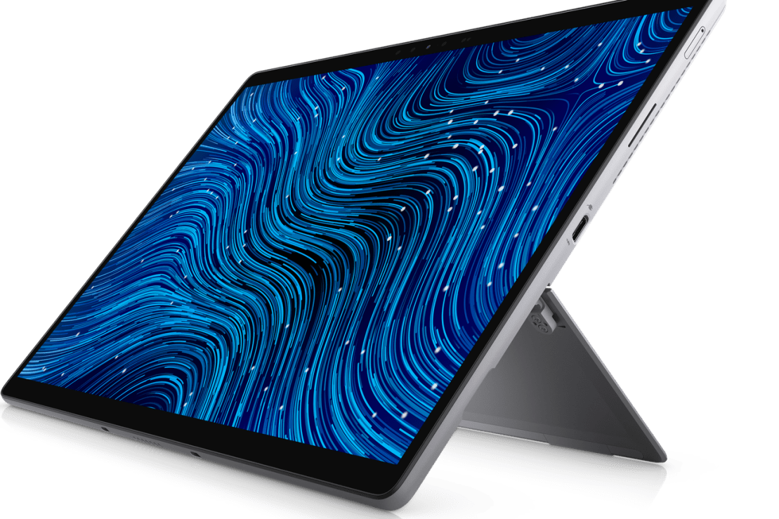 The Dell Latitude 7320 Detachable with the kickstand extended, angled to the left. The screen displays a blue striped pattern.
