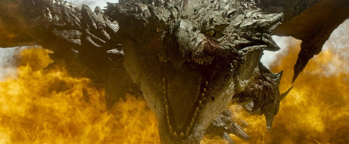 Rathalos, a roaring dragon-type beast, surrounded by flames in Monster Hunter