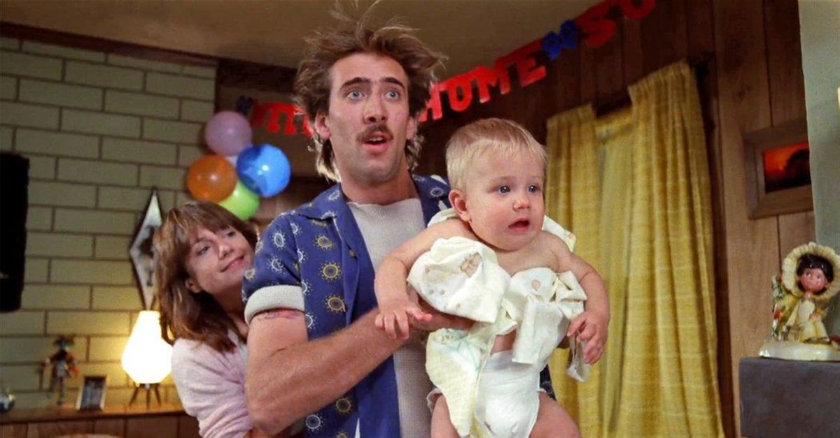 Nic Cage is holding a baby