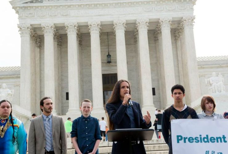 Earth Guardians Youth DirectorXiuhtezcatlMartinez, one of the plaintiffs in the Juliana v. US climate lawsuit, speaks outside the US Supreme Court in 2017.