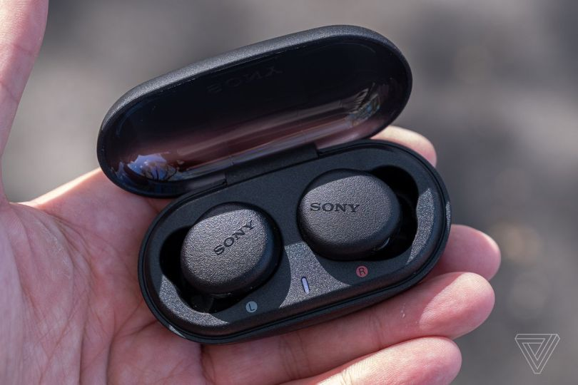 An image of the Sony WF-XB700, the best wireless earbuds if you can get a deal, in someone's hand.