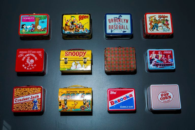 12 lunch boxes mounted on a wall at eBay.