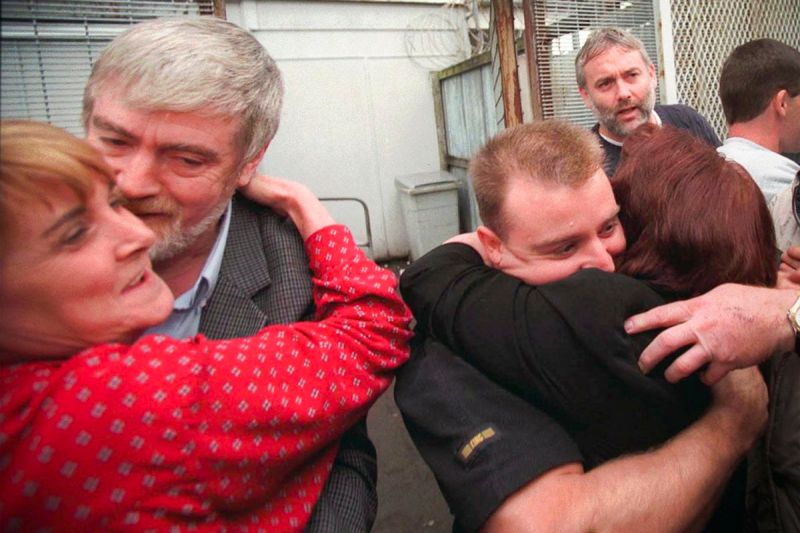 Convicted IRA members Louis McNally (left) and Sean McGuigan are welcomed by relatives after being released from the Maze Prison in Lisburn, Northern Ireland, on Friday, Sept 11, 1998. They were among the first prisoners to be released by the British gove