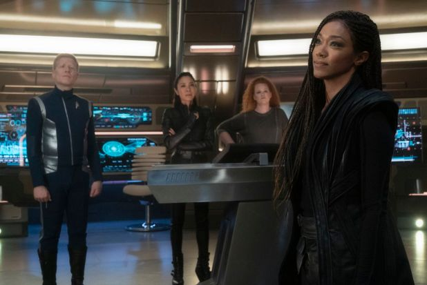 Anthony Rapp, Michelle Yeho, Mary Wiseman and Sonequa Martin-Green on the Bridge of Discovery at Star Trek.
