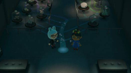 Two villagers stand in the fossil wing of the museum in Animal Crossing: New Horizons