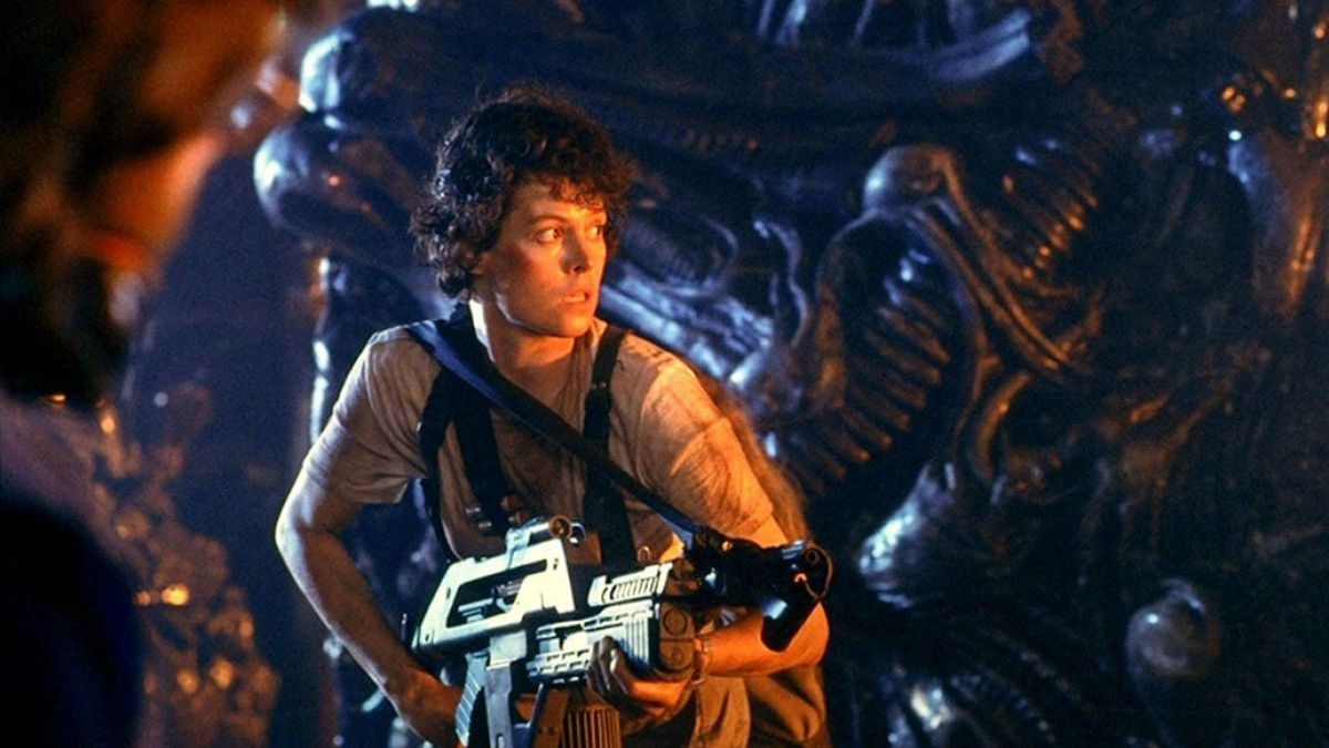 Ellen Ripley holding a firearm in the xenomorph hive in Aliens