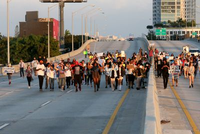 Protesters march in Miami. Florida is one of the states considering making it more difficult to charge motorists who strike protesters.