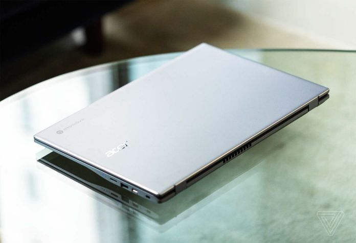 The lid of the Acer Chromebook 515 as seen from above on a clear table.