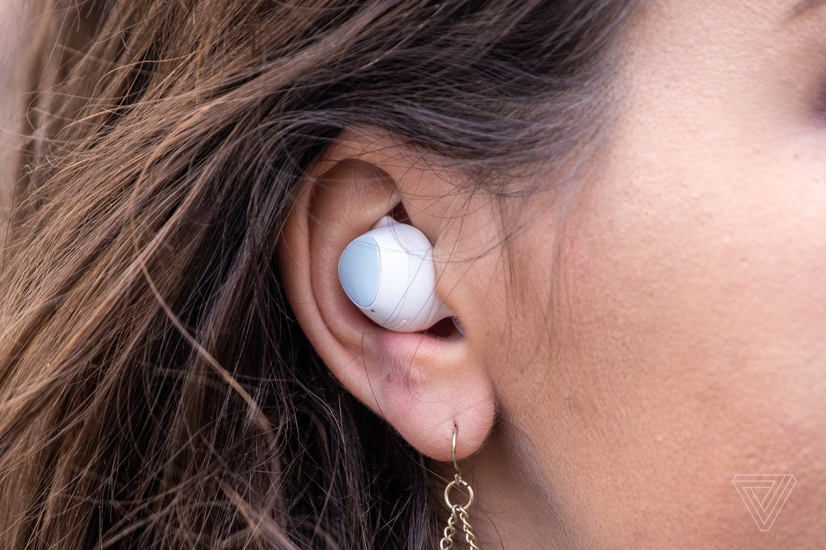 Samsung's Galaxy Buds Plus, the best wireless earbuds for most people, pictured in a woman's ear.