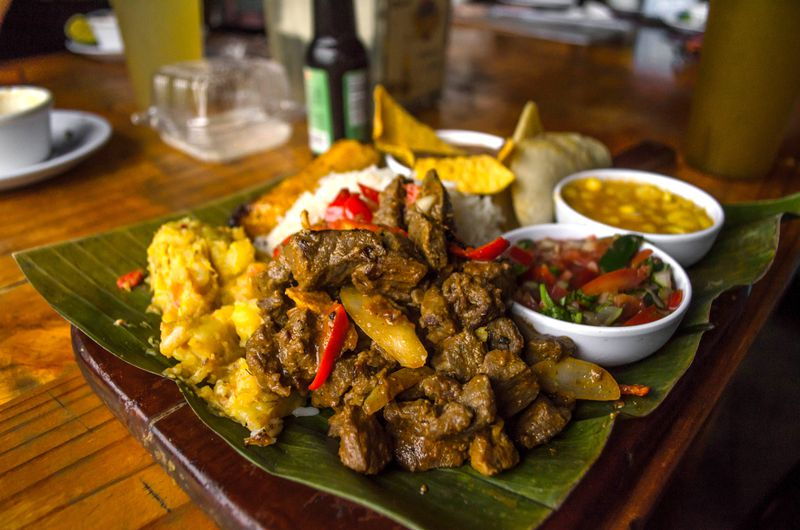 A banana leaf is spread with a mixture of traditional Costa Rican foods.