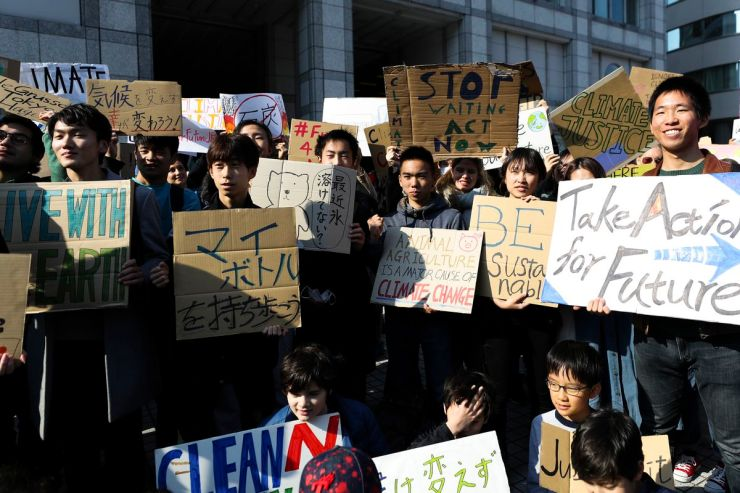 Participants gather at United Nations University for the Fridays for Future march on March 15, 2019 in Tokyo, Japan.