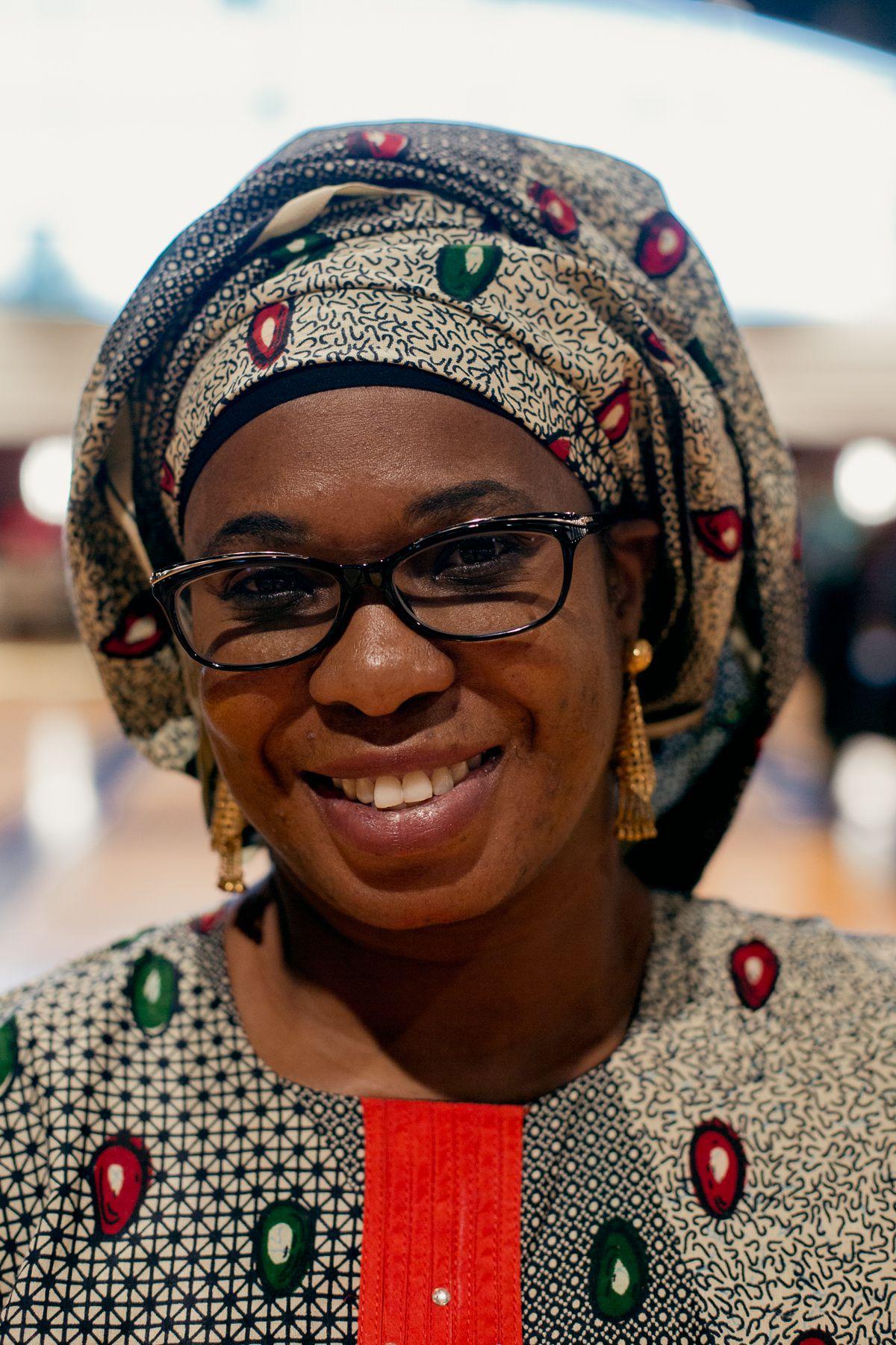 A woman in a gele, a Nigerian headwrap