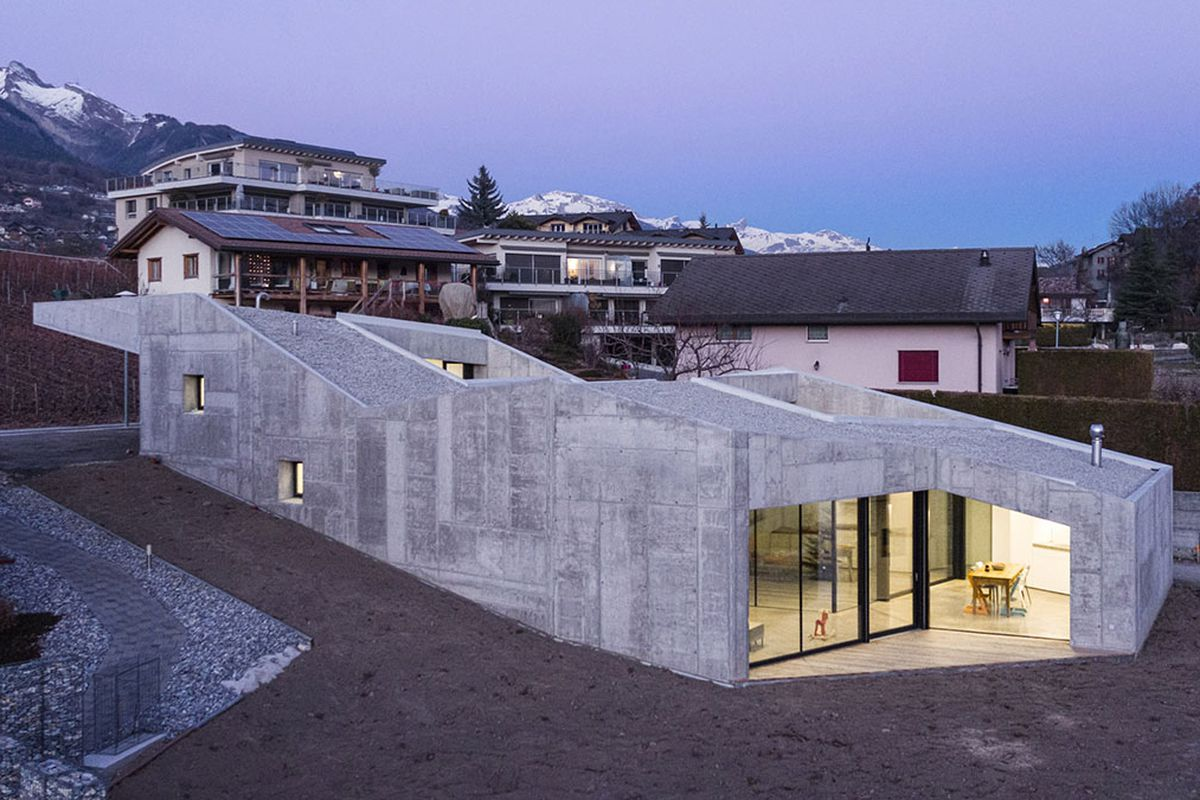 Concrete Home Climbs Up Small, Sloping Site In Switzerland