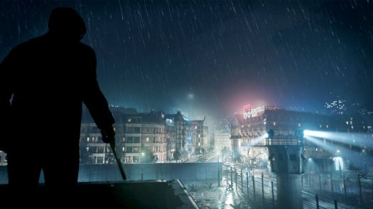 A silhouetted figure with a gun stands on a rooftop in the rain in Black Ops Cold War