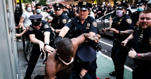 Images of police using excessive force against peaceful ...