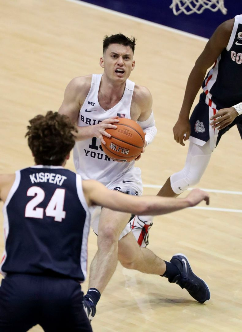 Brigham Young Cougars guard Alex Barcello (13) looks to shoot in front of Gonzaga Bulldogs forward Corey Kispert (24) during a basketball game at the Marriott Center in Provo on Monday, Feb. 8, 2021. BYU lost 71-82.