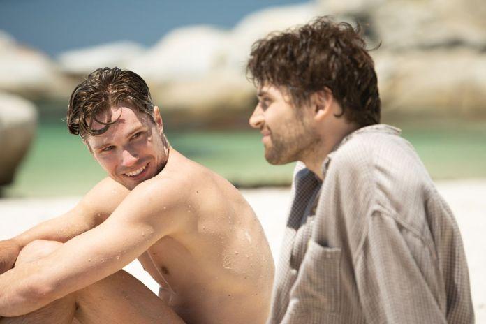 Kai Luke Brummer stars at another man in Moffie