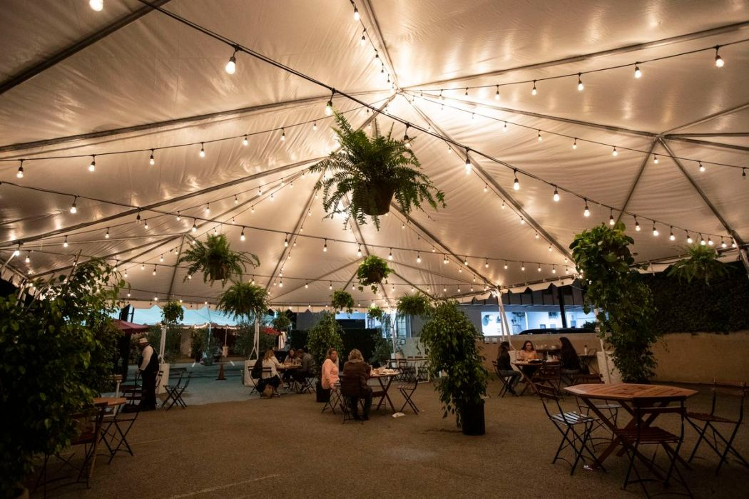 Casa Vega's expansive new outdoor dining area with hanging lights and scattered tables.