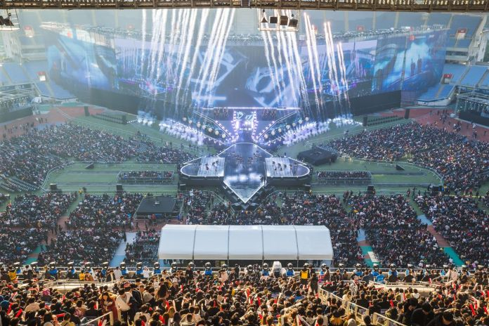 A massive crowd sits in South Korea's Munhak Stadium watching the pre-show for the League of Legends 2018 world finals