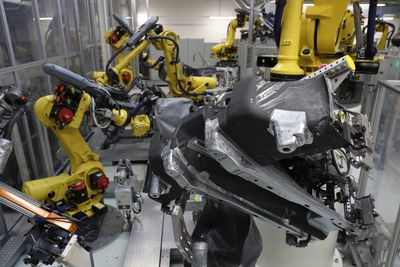Industrial robots weld portions of the undercarriage of Volkswagen Golf cars at the Volkswagen car factory on May 19, 2017 in Wolfsburg, Germany.