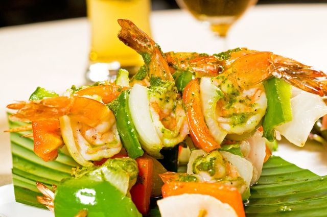 Shrimp on a skewer with peppers and onions is a delicious, healthy option for barbecue fare this summer.