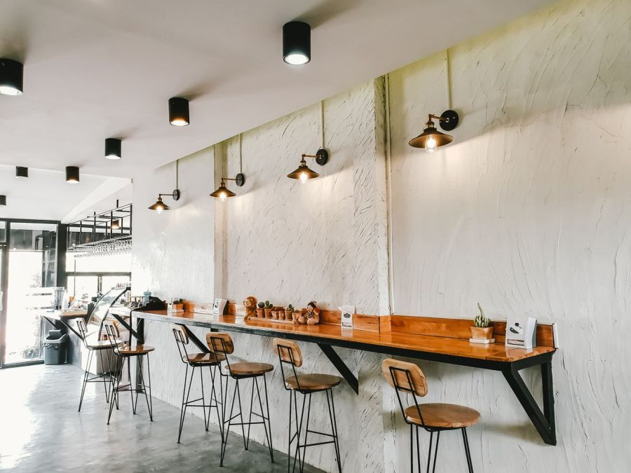 A cafe with white walls and bar-style seating